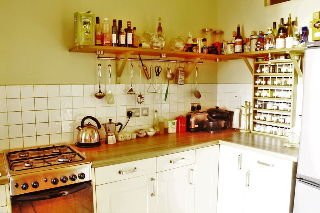 The kitchen features a bespoke spice rack.