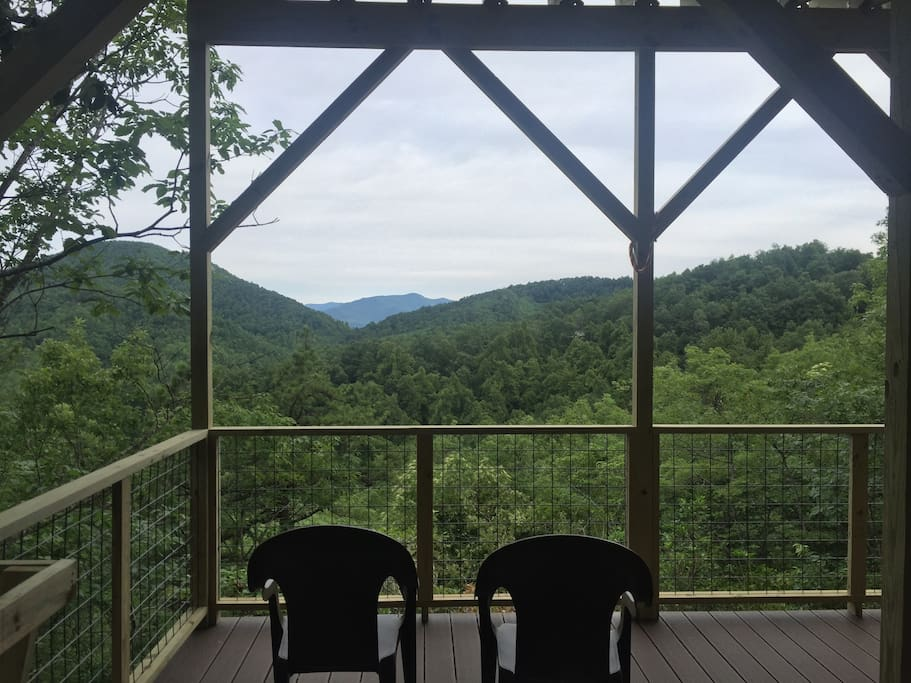 Sitting in the chair and watching birds and clouds tiptoe around the mountains.
