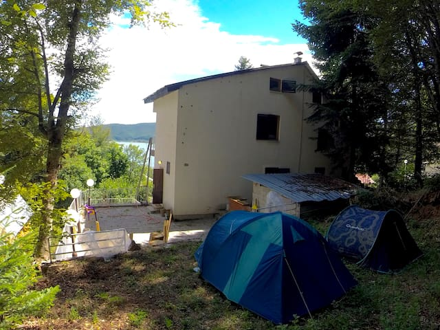 The Base Camp hidden in the forrest shadow... even the hottest days in Mavrovo, you might need to put a long sleeve :)