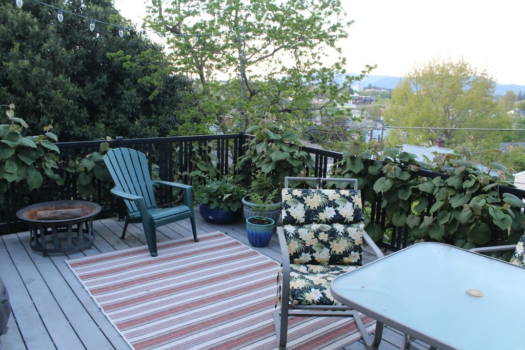 Back deck facing toward downtown and UO campus. Available for drinks or evening fire.