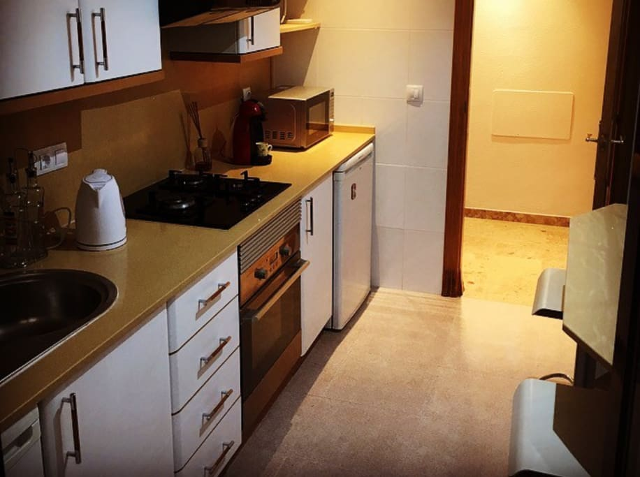 Fully equipped kitchen has two refrigerators, gas, microwave, coffee machine, kettles, tableware and many more.