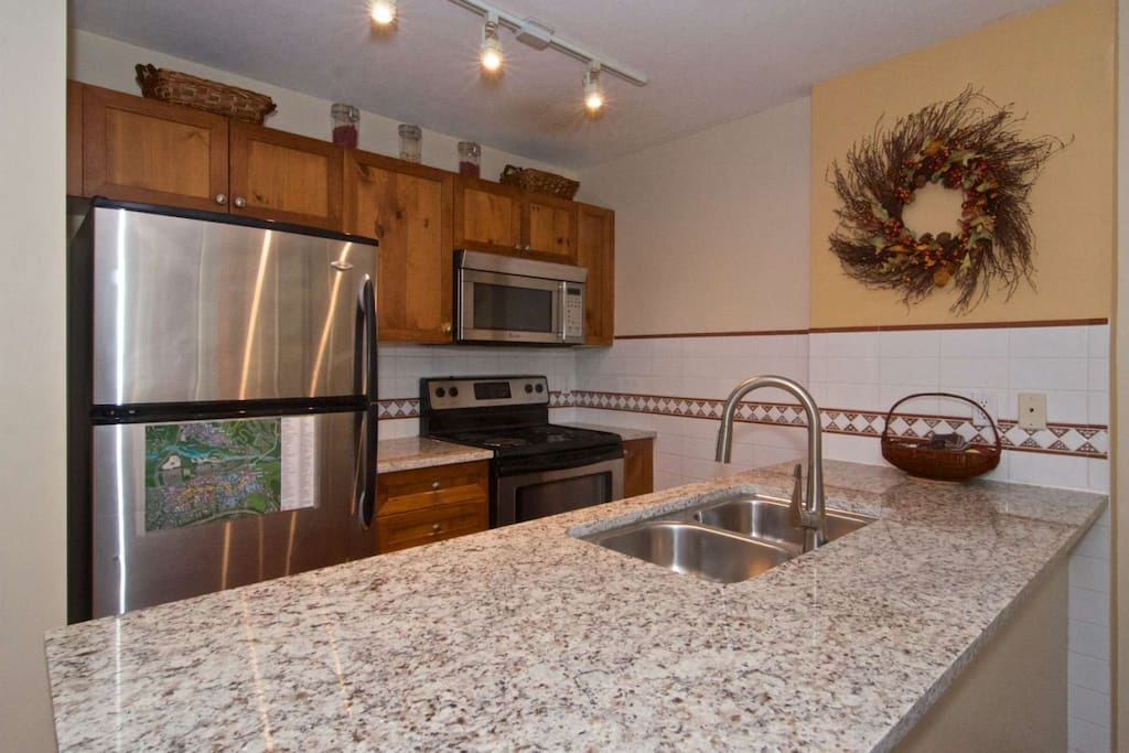 Updated kitchen with new counter-tops and stainless steel appliances