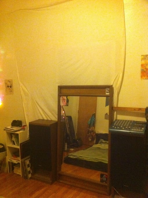 Huge mirror, two big speakers, and the sheet is for my projector.