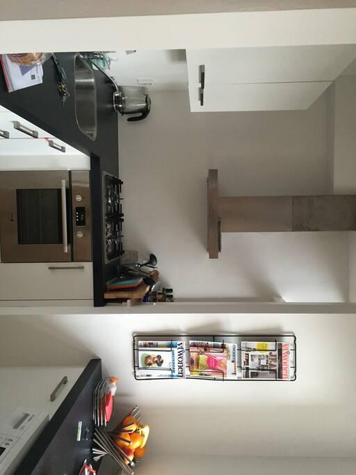 Kitchen with washing machine, dish washing machine, oven, water cooker and coffee machine