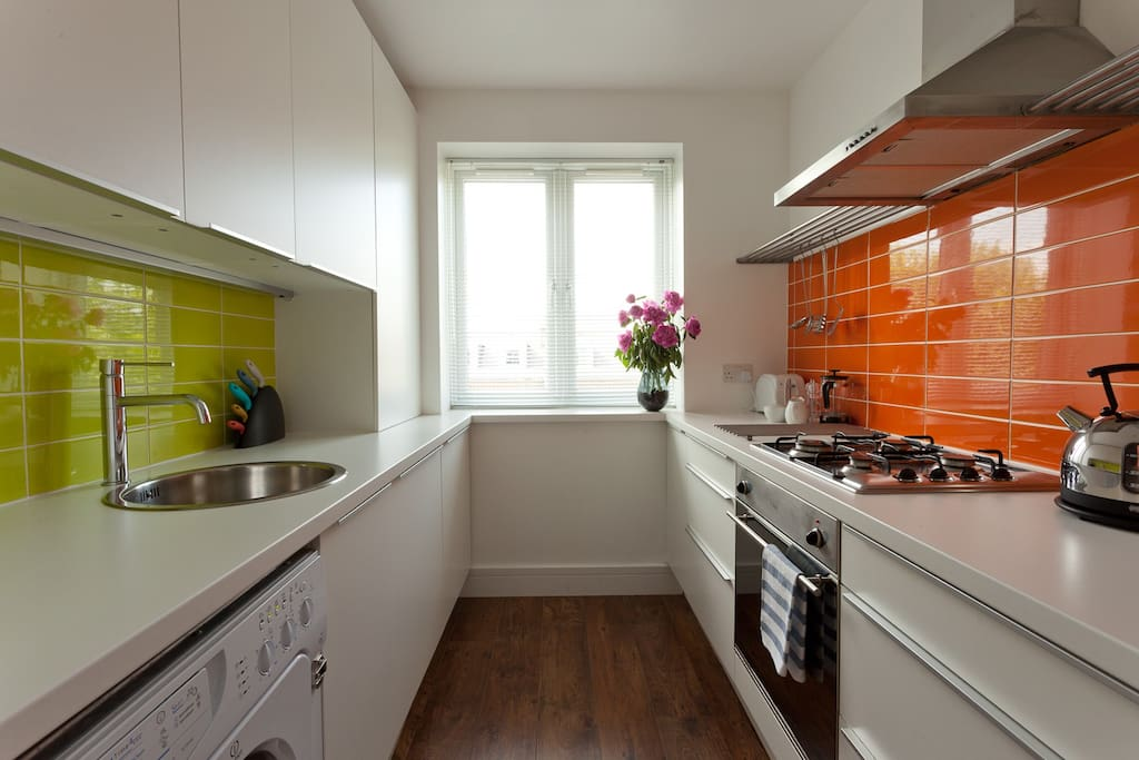 Superb compact kitchen with all that you need, plus some pops of colour to make you smile