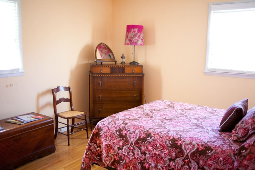 The Master Bedroom: Furnished with a queen bed and private bath.