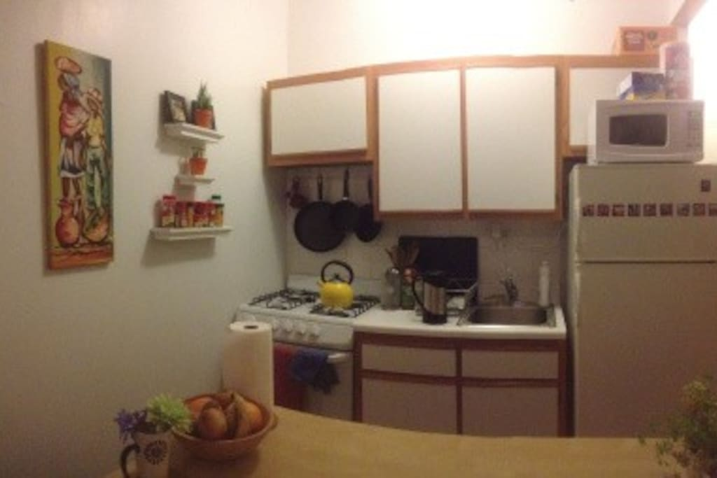 Full, clean kitchen with dining space.