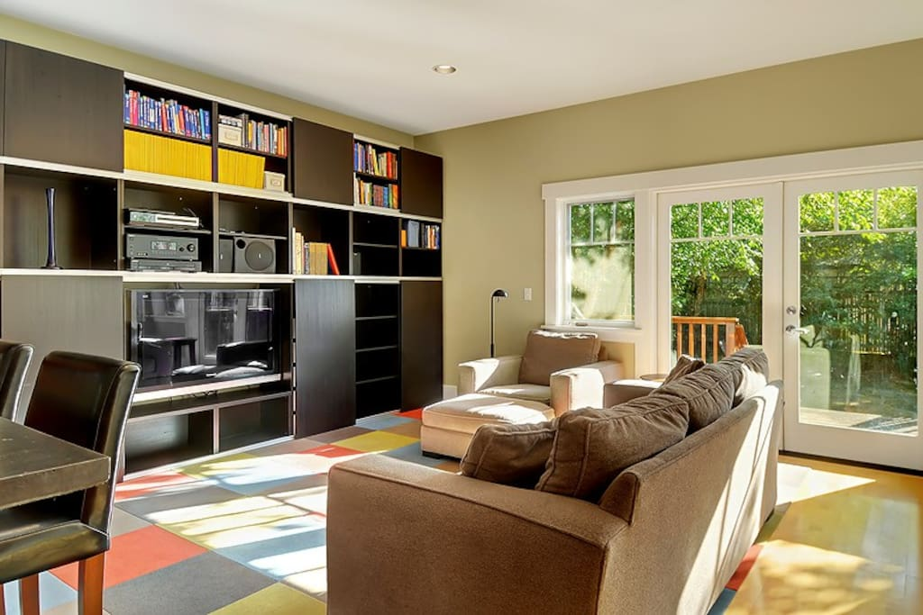 Entertainment center in private family room open to kitchen