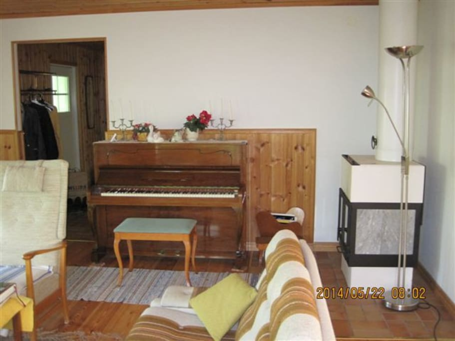 Living room - piano and fireplace