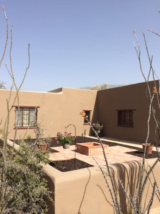 Back courtyard with fire pit and patio