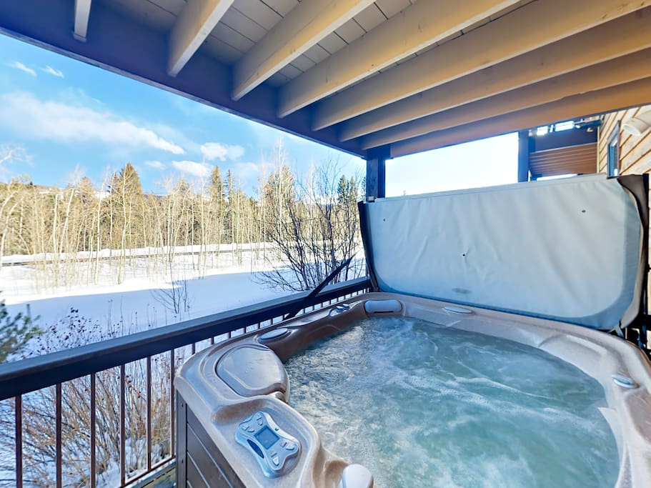 Covered deck with private hot tub and a nice views of the Continental Divide.