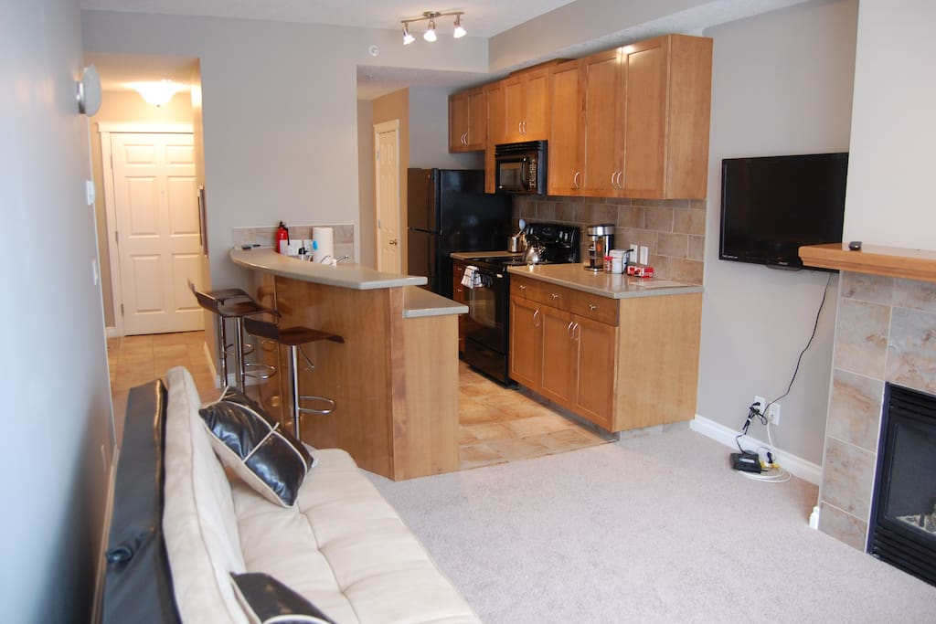 Open concept kitchen and living room provides a very roomy feeling.  With the instant-on gas fireplace.