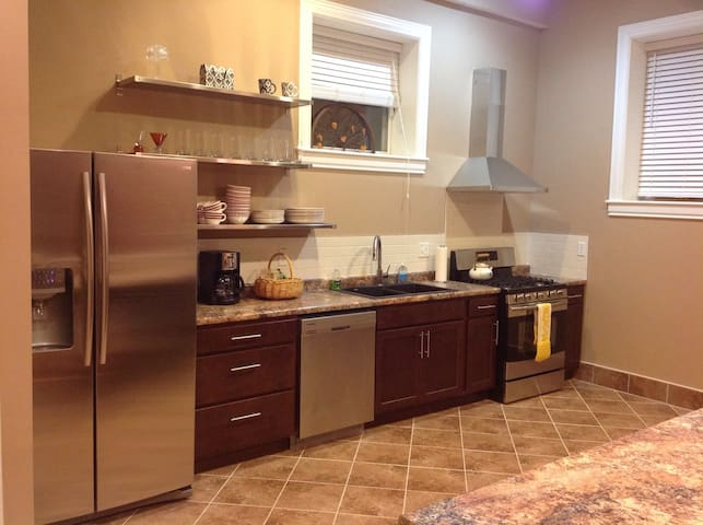 This kitchen has many upgraded features - large, double sinks, toaster, coffee maker, lots of cooking tools & more