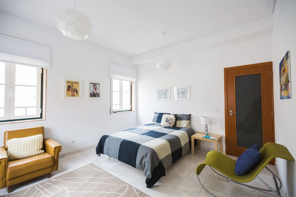 Bedroom equipped with bed linens, iron and table, umbrella for the beach, heater and fan.