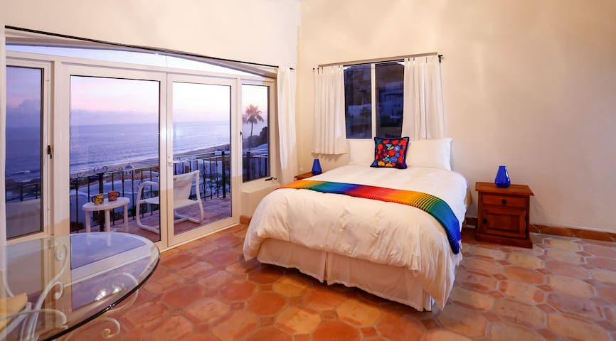 Queen bedroom ensuite includes a small dining table, small kitchenette area and outdoor seating for two.