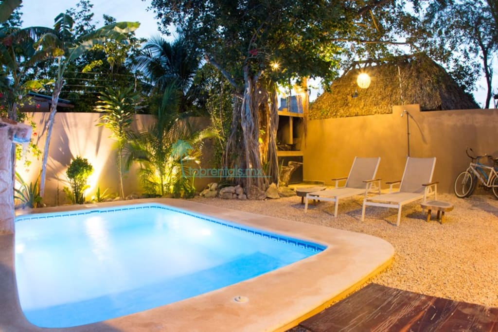 Private pool at night and bbq