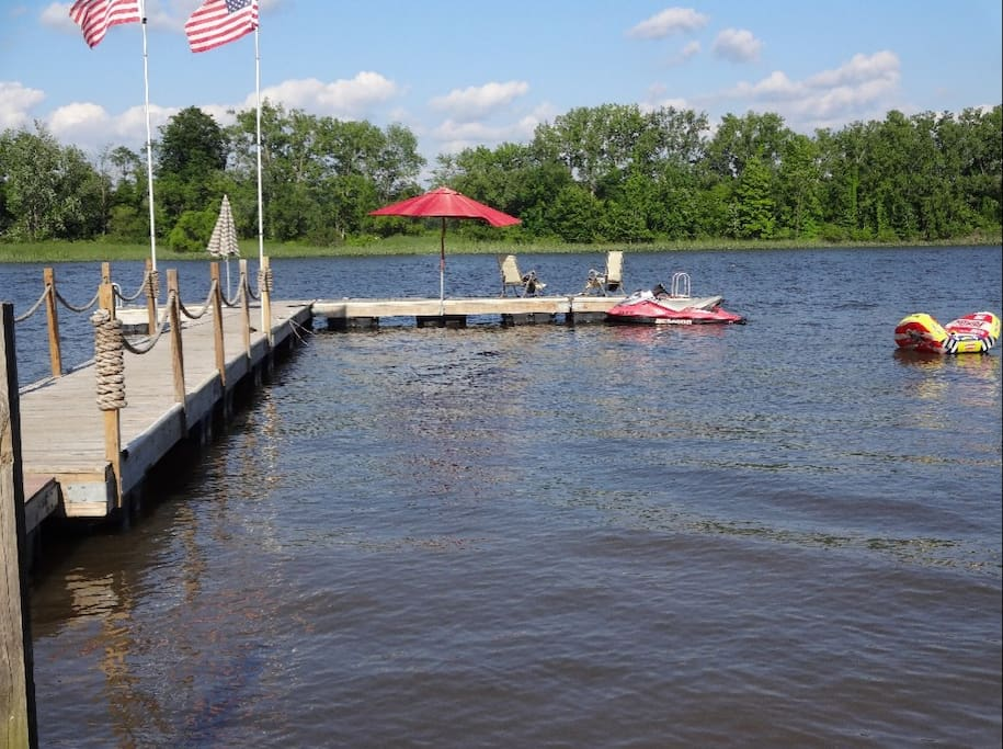 Private dock and sandy beach.  Bring your boat or jet ski
