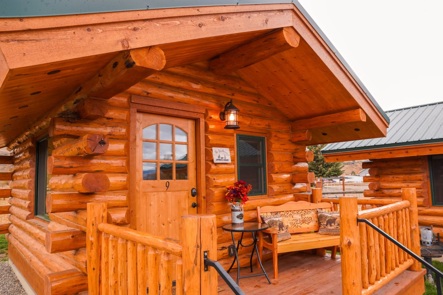 The Bunkhouse Cabin is a cozy 12 x 16 foot custom log cabin, and offers a beautiful, sturdy bunk bed, with a comfortable twin bunk, over a  full-size futon (coil spring mattress) which makes out to a full-size bed.