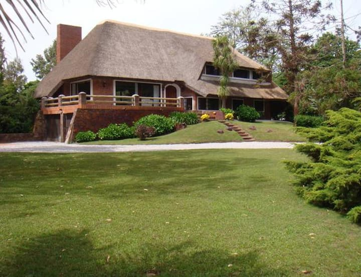 Outstanding thatched villa minutes from the beach