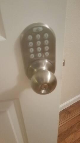 Private  locked bedroom door and front door  with keypad