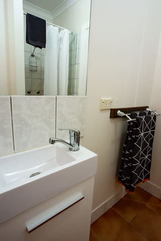 Bathroom.  Shower recess and separate bath