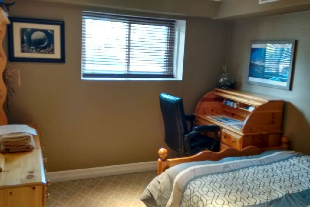 Bright clean room with desk and internet access.