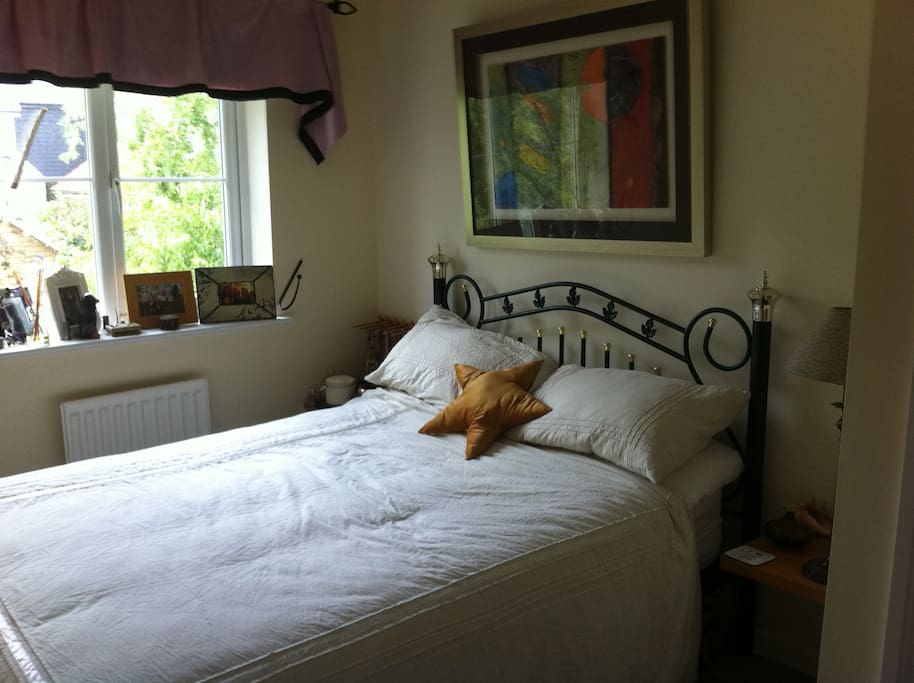 2nd bedroom with double bed, double wardrobe, roller blind, full bathroom with shower attached.