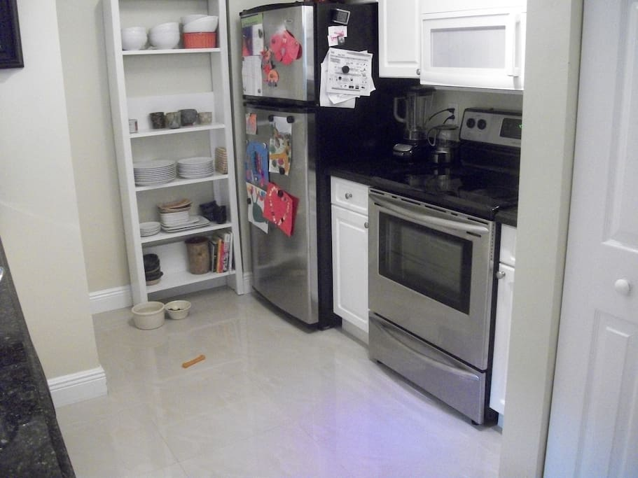 Fully equipped kitchen with washer and dryer, dishwasher, microwave, stove/oven, refrigerator/freezer, disposal, pantry.