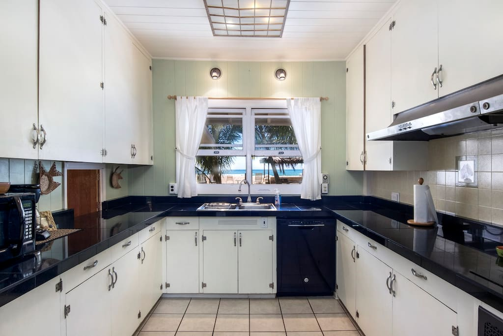 Huge Kitchen with 6 burner glass-top range, black granite countertops, and Oceanview