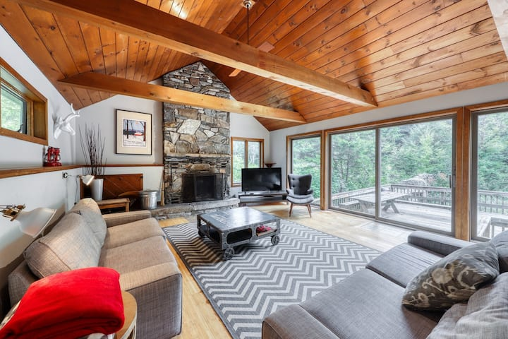 Roomy, riverfront home w/deck, fireplace - golf, skiing, town at your fingertips