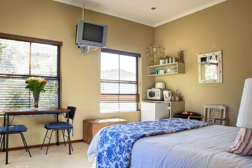 The main bedroom consists of Television with full DSTV, fridge, microwave, kettle and toaster
