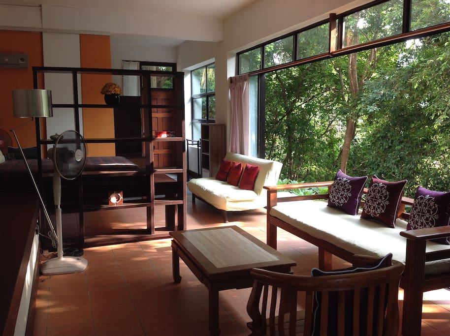 The spacious living area, which opens up to the jungle!