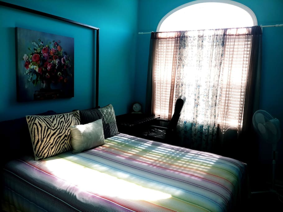 cozy queen bed with good sunlight during day