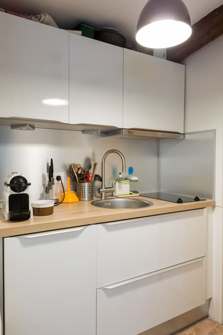 Kitchen with coffee machine. Coffee capsules are provided