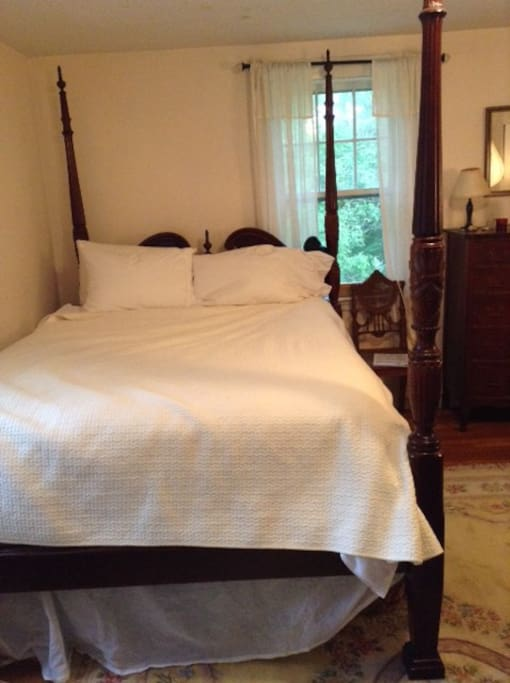 comfortable queen four poster bed with new firm mattress and box spring