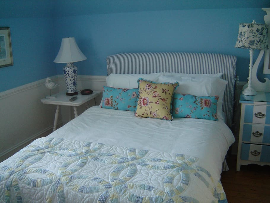 Queen Size Bed in cheery blue and white setting
