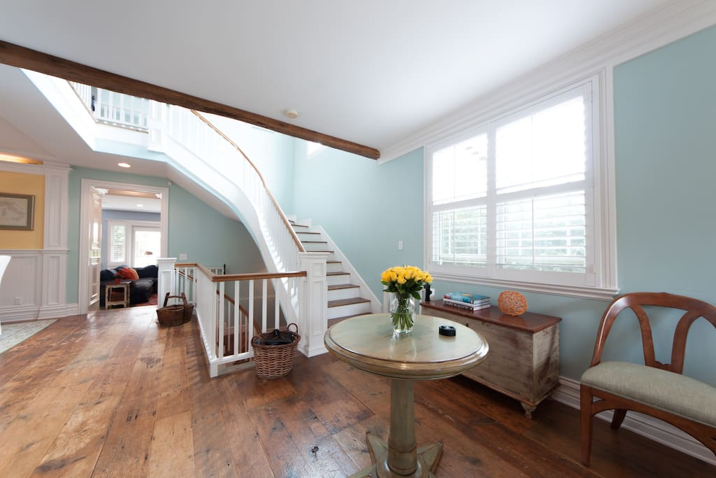 Home features many architectural elements, such as 200 year-old reclaimed wood floors.