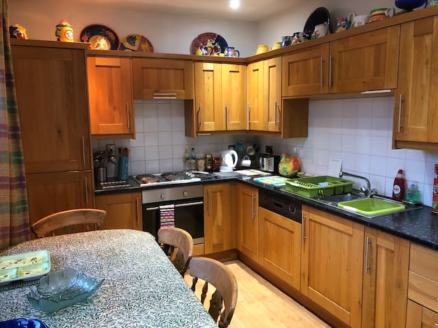 The wonderful shared fully equipped kitchen. All guests can use this and make themselves a tea or coffee or make their tea. There are places to eat out and shops eg Coop open until 10pm. We ask guests to call us should they need anything.