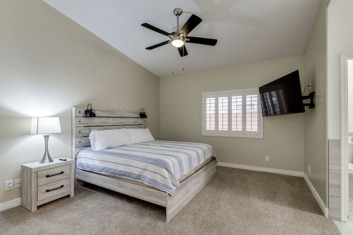 1 of 3 bedrooms. (Master Bedroom). King bed. New carpet, new king bed, new 65 inch 4k t.v., new king mattress, new dresser, new lamp, new shutters, new everything.
