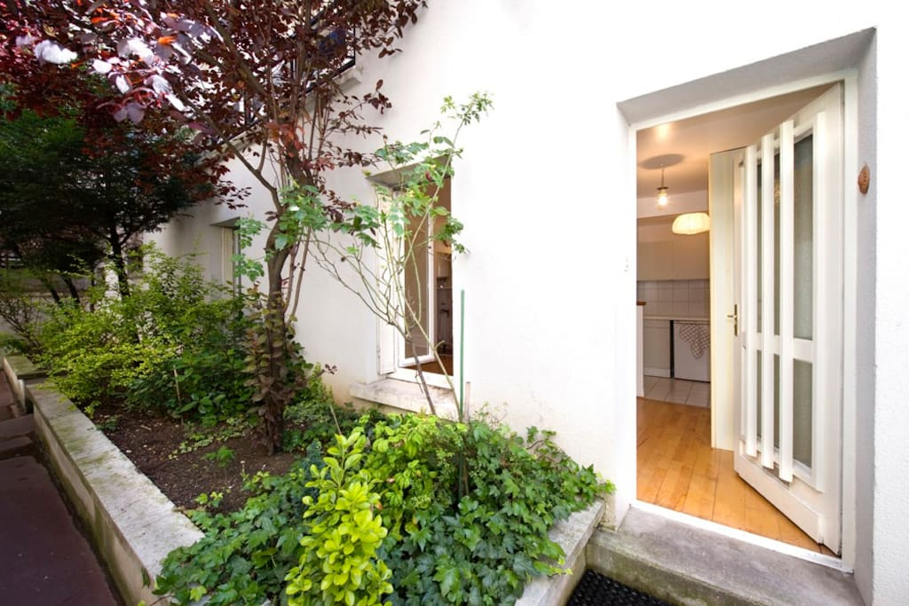 Welcome to the apartment located in a flowered courtyard