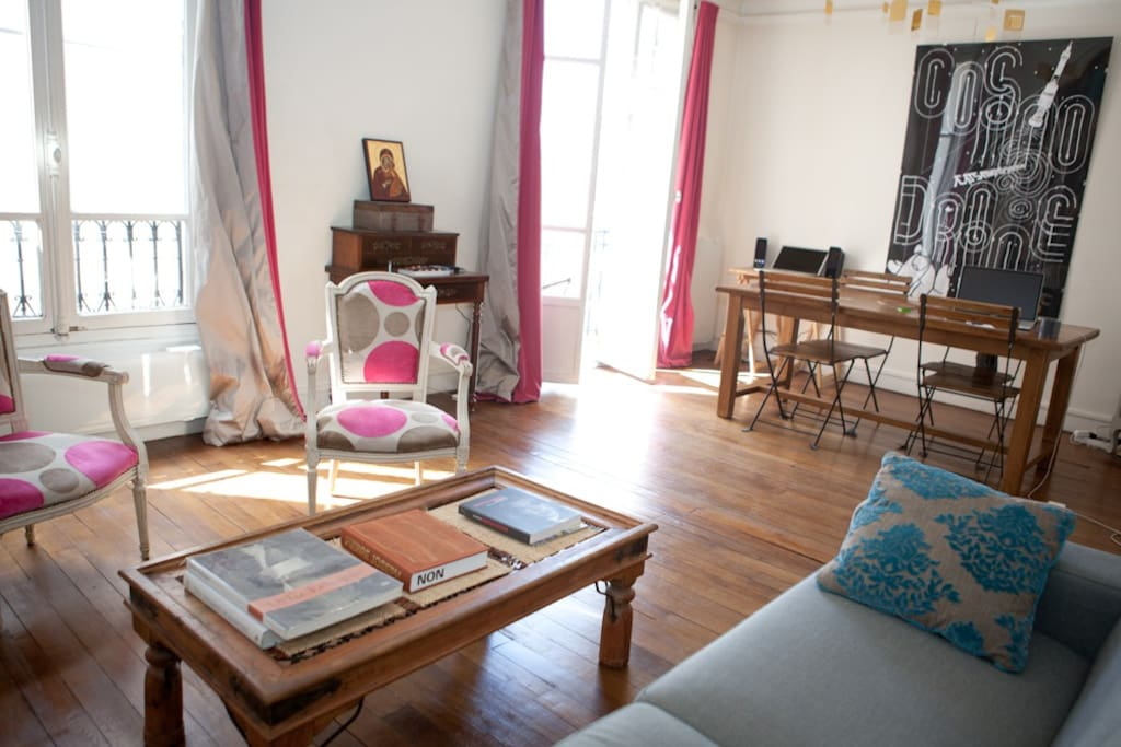 The 20 square meters living room has 2 windows facing street. It is equipped with : double sofa bed, coffee table, stereo, 2 armchairs, wooden table with four chairs, built-in wall closet, hard wood floor.