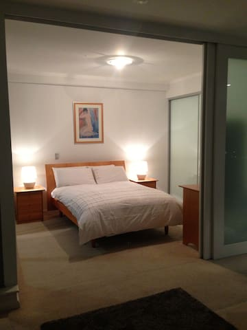 Bedside drawers and floor to ceiling built in wardrobes