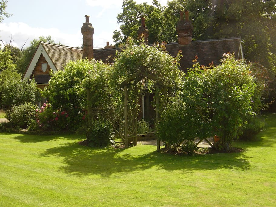 The Cottage from the side, with the garden and Rose Pergola