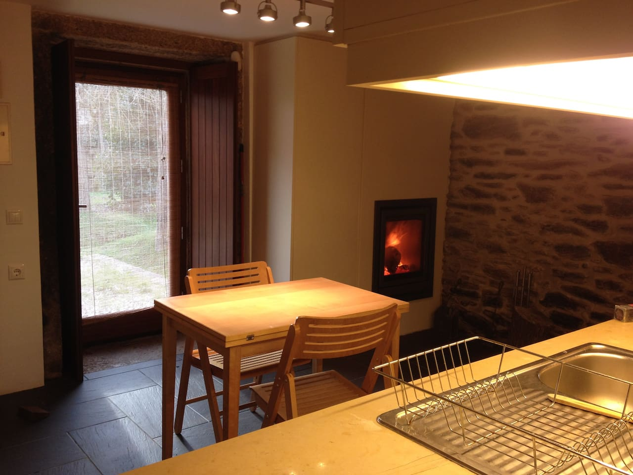 Kitchen with fireplace.