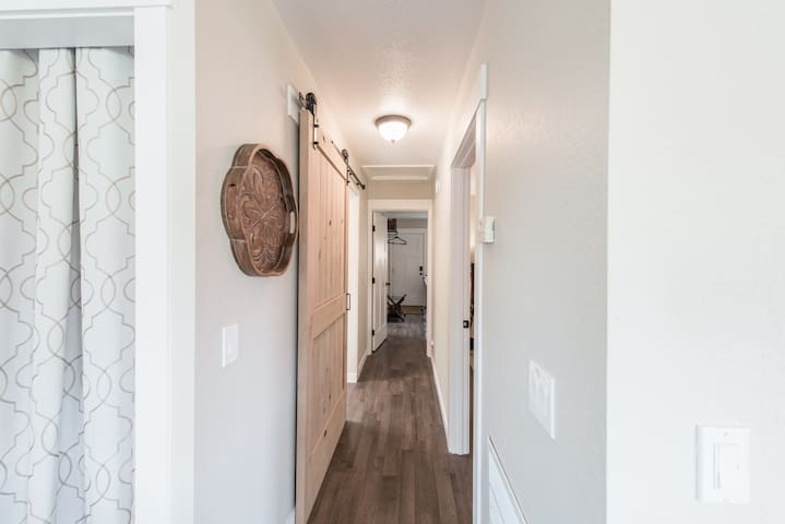 A sliding barn door to the 2nd bathroom provides style and privacy.