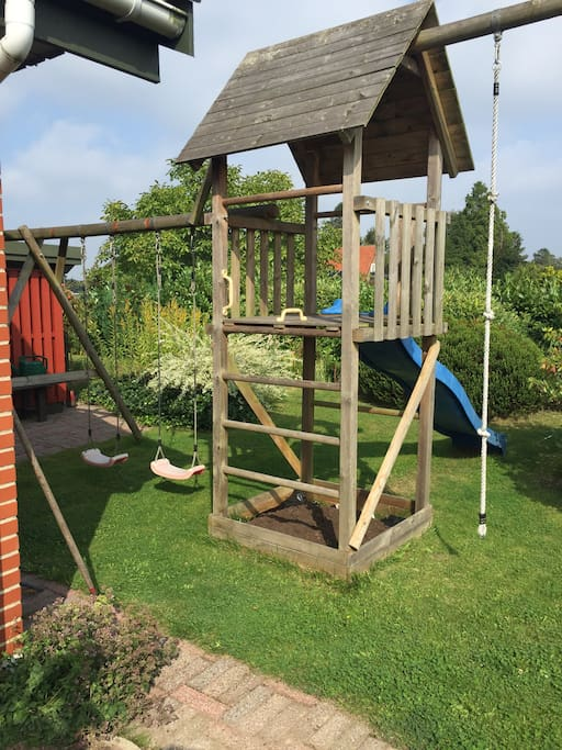 The  view from the room. You look out into my garden. This is my granddaughters playhouse.