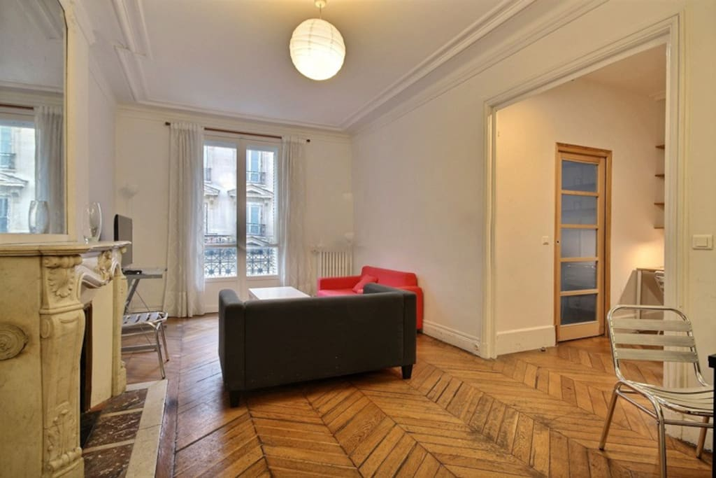 Living   The 22 square meters living room has a double glazed window facing street . It is equipped with : dining table for 6 people, sofa, single sofa bed, coffee table, TV, decorative fireplace, hard wood floor.