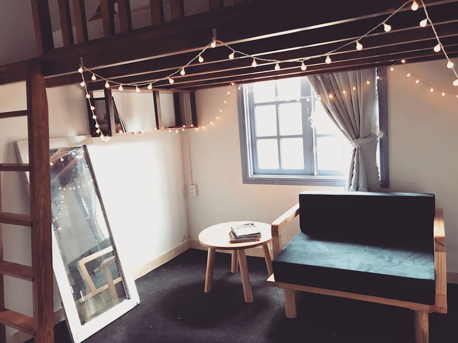Room 2 - Fun and creative living place with 1 king size bed. Need to climb up a stair to get to the bed. We can also put an extra floor mattress for you :)