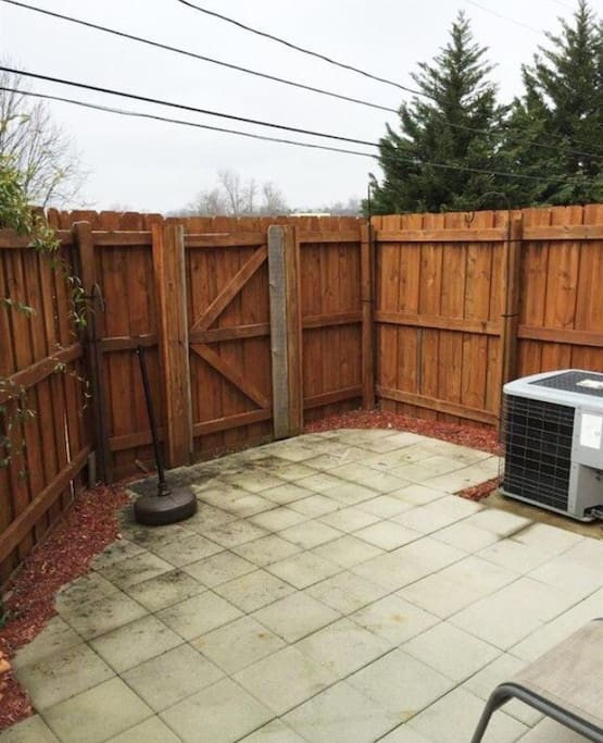 Fenced in back patio to chill