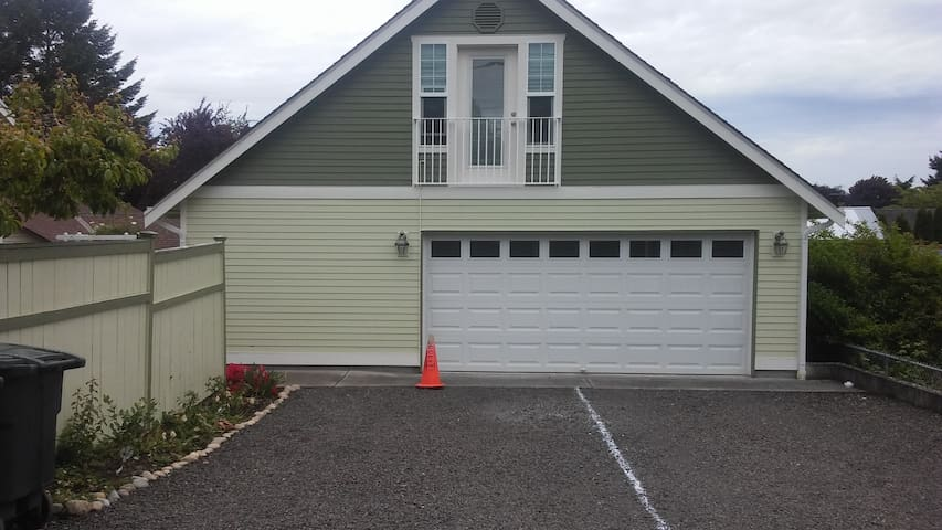 Guest Parking is on the Left .  Located behind the house and accessed  on Ryan Street.  (Cross-street to 6th Ave NE)  Poulsbo's  Perch is above the garage.  Access is around the corner to the left.